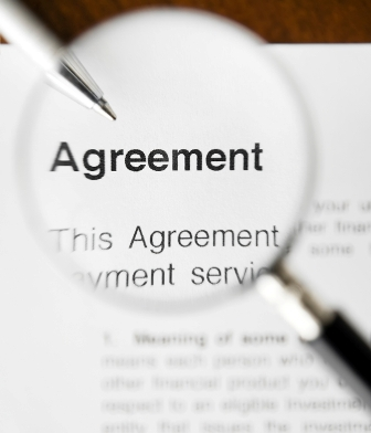 Magnifying glass over the word Agreement