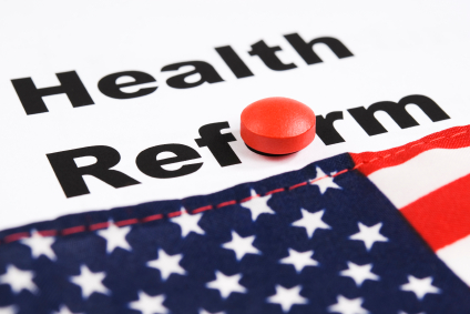 health reform spelled out with a red pill for the letter o